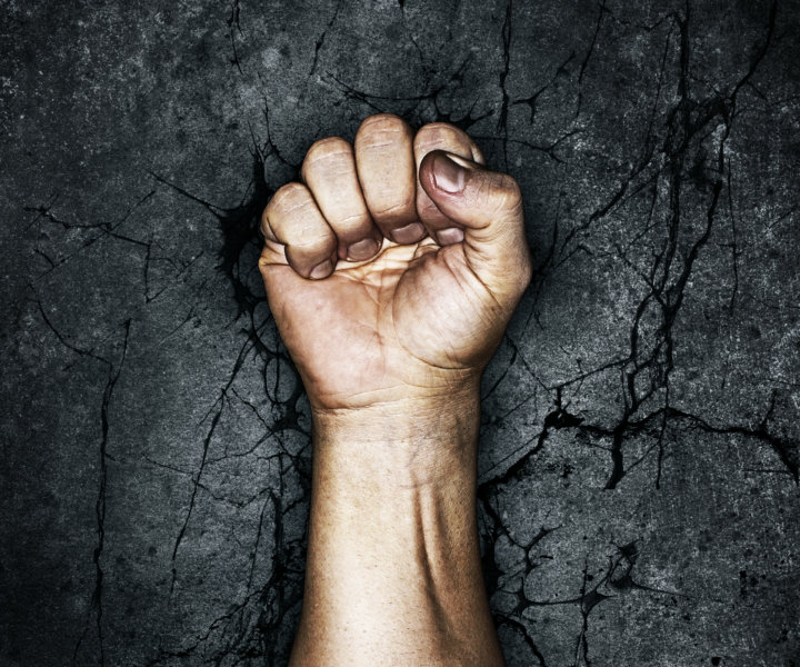 Grungy fist raised in protest